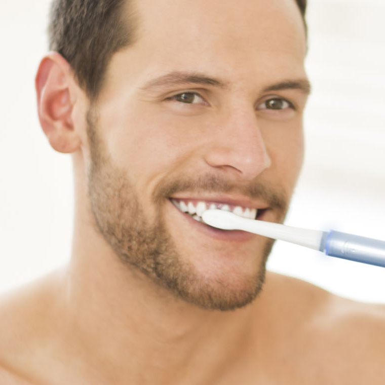 Generic-dentist_SMM_man-brushing-teeth-with-electric-toothbrush.jpg
